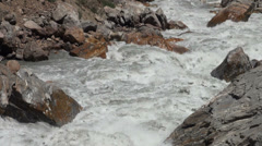 Raging river separates Afghanistan from Tajikistan Stock Footage