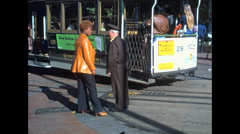 San Francisco 1976: coloured woman talking with the conductor of the cable car - stock footage