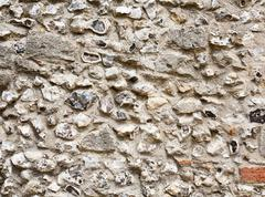 flint stone wall - stock photo