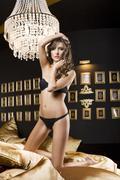 Girl in lingerie in dark luxory room Stock Photos