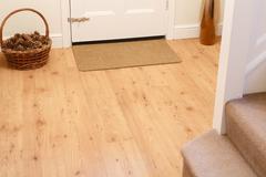 Wooden floor in entrance hall Stock Photos