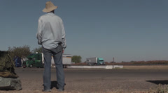 Homeless hitch hiker, truck stop Stock Footage