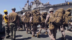 US-Soldiers Walkling Along Carrier 01 - stock footage