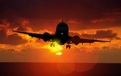 airplane landing at dusk - stock illustration