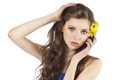 Fresh girl with yellow flower Stock Photos