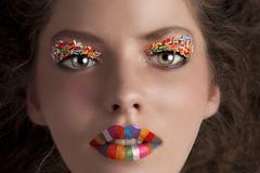 Face shot of a young girl wearing candy make up Stock Photos