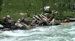 Wrecked Lada on the side of a river, car wreckage, accident, old and rusty Stock Footage