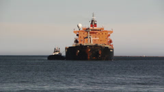 Gas and Oil Tanker Enters Port Stock Footage