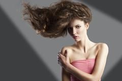 Pretty girl with great hair style, she has left hand on the right shoulder Stock Photos