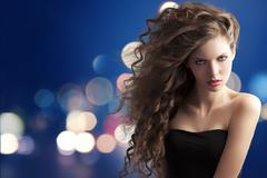 brunette with creative hairstyle on bokeh - stock photo