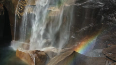 RAINBOW AT WATERFALL - stock footage