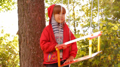 Girl playing, laughing on a swing Stock Footage