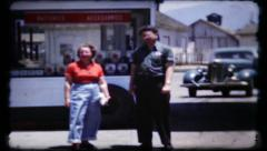 393 - woman gets her car repaired at Mexican Garage - vintage film home movie Stock Footage