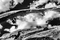 landscape arch close up black white rock canyon devils garden arches national - stock photo