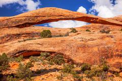 landscape arch close up blue sky rock canyon devils garden arches national pa - stock photo
