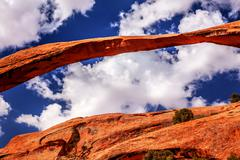 landscape arch close up rock canyon devils garden blue sky arches national pa - stock photo