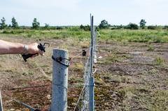Loosen electric fence Stock Photos
