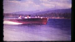 387 - classic wooden boat wide open & fishing - vintage film home movie Stock Footage