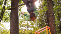 Boy somersaults on the bar, and climbs a tree Stock Footage