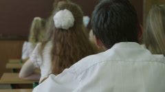 Teacher and students on lesson - stock footage