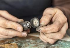 Hands of a Jeweller - stock photo