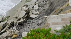 Broken brick wall and landslide debris Stock Footage