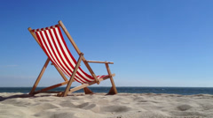 Copyspace deck chair at the beach with space for text in summer Stock Footage