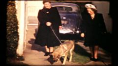 381 - ladies walking the German Shepherd dog - vintage film home movie Stock Footage