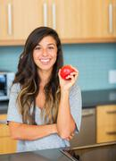 beautiful woman with an apple - stock photo