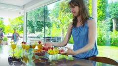 Happy group of friends drinking healthy juice drinks in kitchen of modern home - stock footage