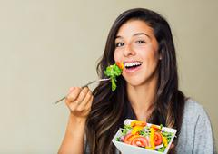 healthy woman eating salad - stock photo
