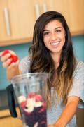 making fruit smoothie - stock photo