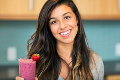 woman with fruit smoothie - stock photo