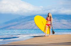 woman with stand up paddle board - stock photo