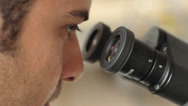 A scientist making analyses in the microscope Stock Footage