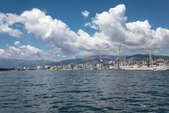 Big clouds over the port of genoa, italy Stock Photos
