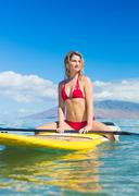 woman on stand up paddle board - stock photo
