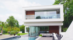 View of the exterior of a luxury contemporary home with no people Stock Footage