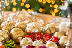 christmas decorations on table - stock photo