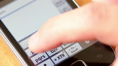 Hands  typing  on  a  touchscreen  smartphone Stock Footage