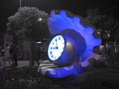 Giant blue pearl and clock in the center of the park rivera Stock Photos