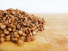 Buckwheat on Wooden Table Stock Photos