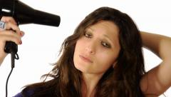 Woman drying her hair with a blow dryer Stock Footage