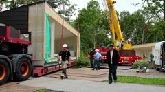 Builders preparing for lifting a pavilion Stock Footage