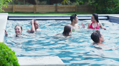 Happy group of young friends enjoying summer pool party Stock Footage