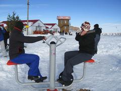 two girls training on the winter ski apparatus - stock photo