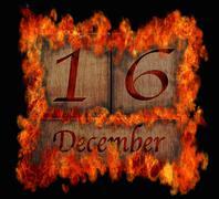 Burning wooden calendar december 16. Stock Illustration