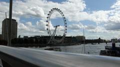 Full view of London Eye wheel taken from Hungerford Bridge (LONDON EYE 10) Stock Footage