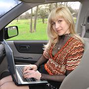 Stock Photo of lady with the laptop in the car