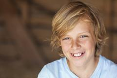Young happy blond boy child smiling Stock Photos